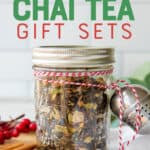 """A glass jar filled with loose leaf is tied to a tea ball with baker's twine. The jar is surrounded by spices. A text overlay reads """"Homemade Chai Tea Gift Sets."""""""