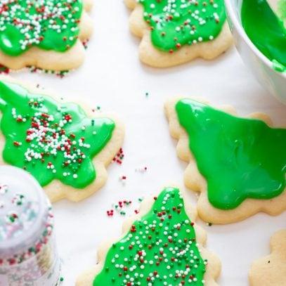 Iced sugar cookies get garnished with sprinkles.