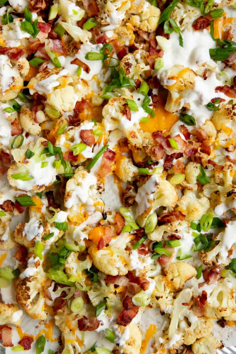 Roasted cauliflower topped with bacon, cheese, green onions, and ranch.