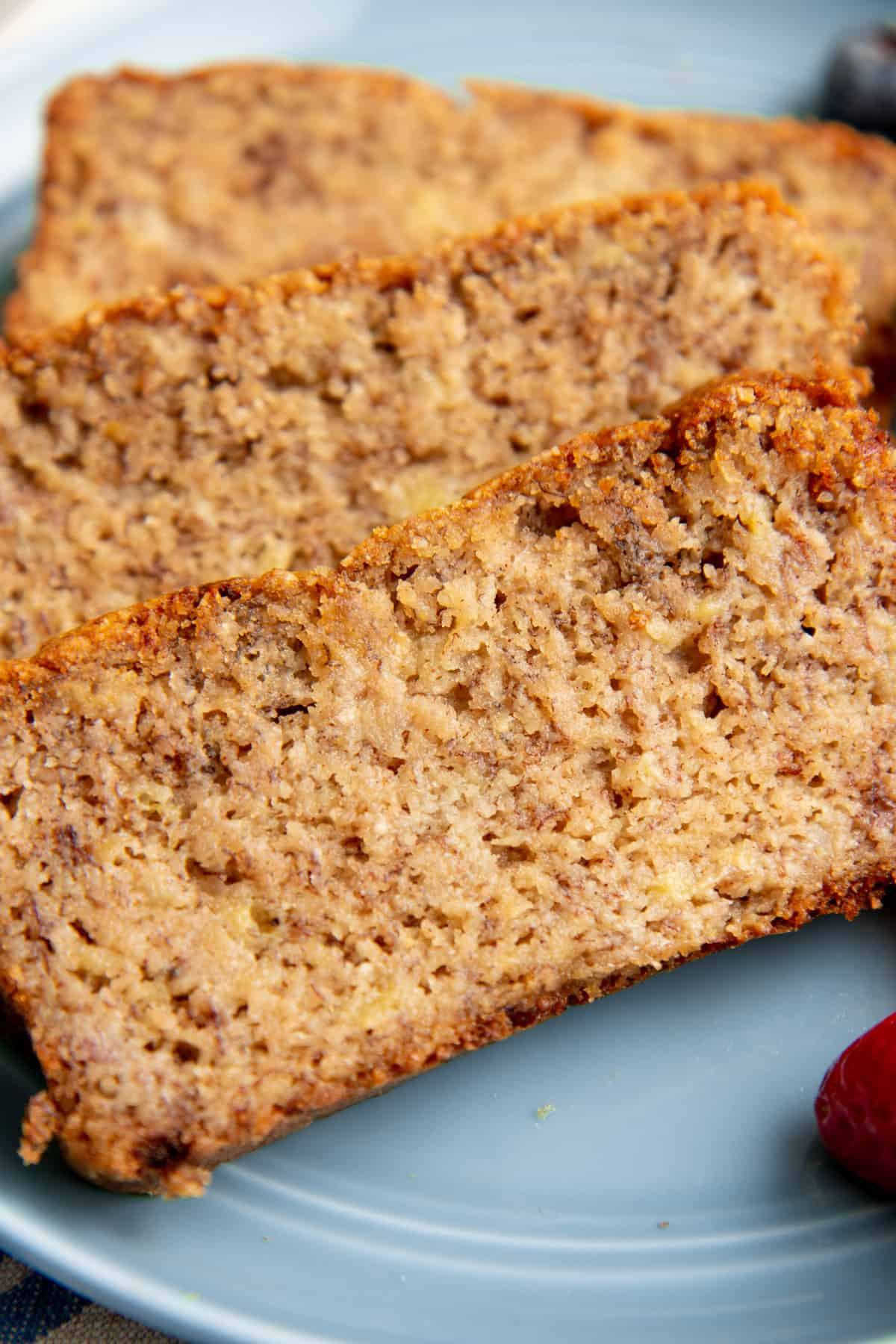 Close up on a slice of paleo banana bread.