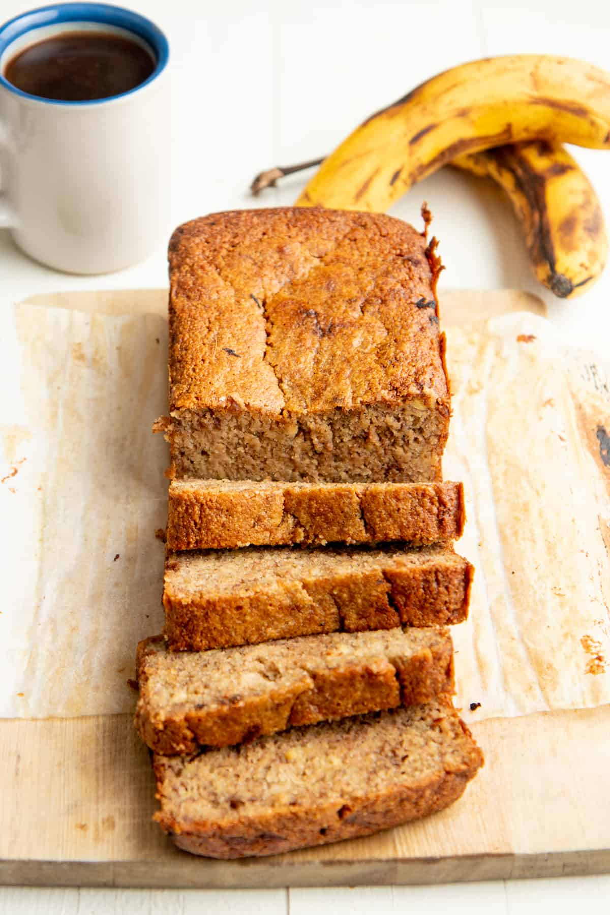 A loaf of almond flour banana bread is cut into slices.