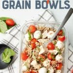 "A glass dish is arranged with ingredients for a caprese grain bowl. A cup of dressing rests in the upper left corner, and additional ingredients surround the container. A text overlay reads ""Meal Prep Chicken Caprese Grain Bowls."""