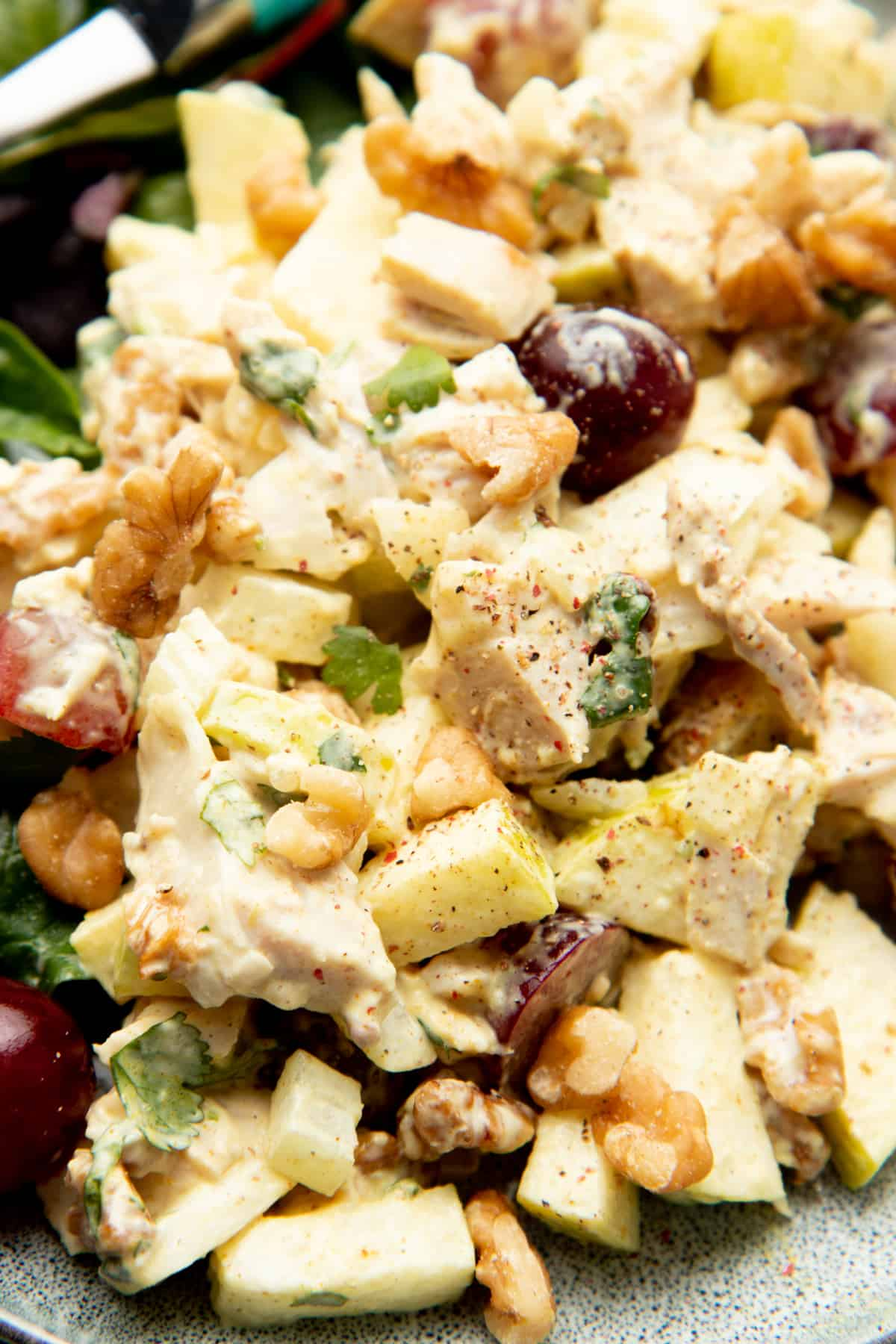 Curry chicken salad includes apples, walnuts, and grapes.