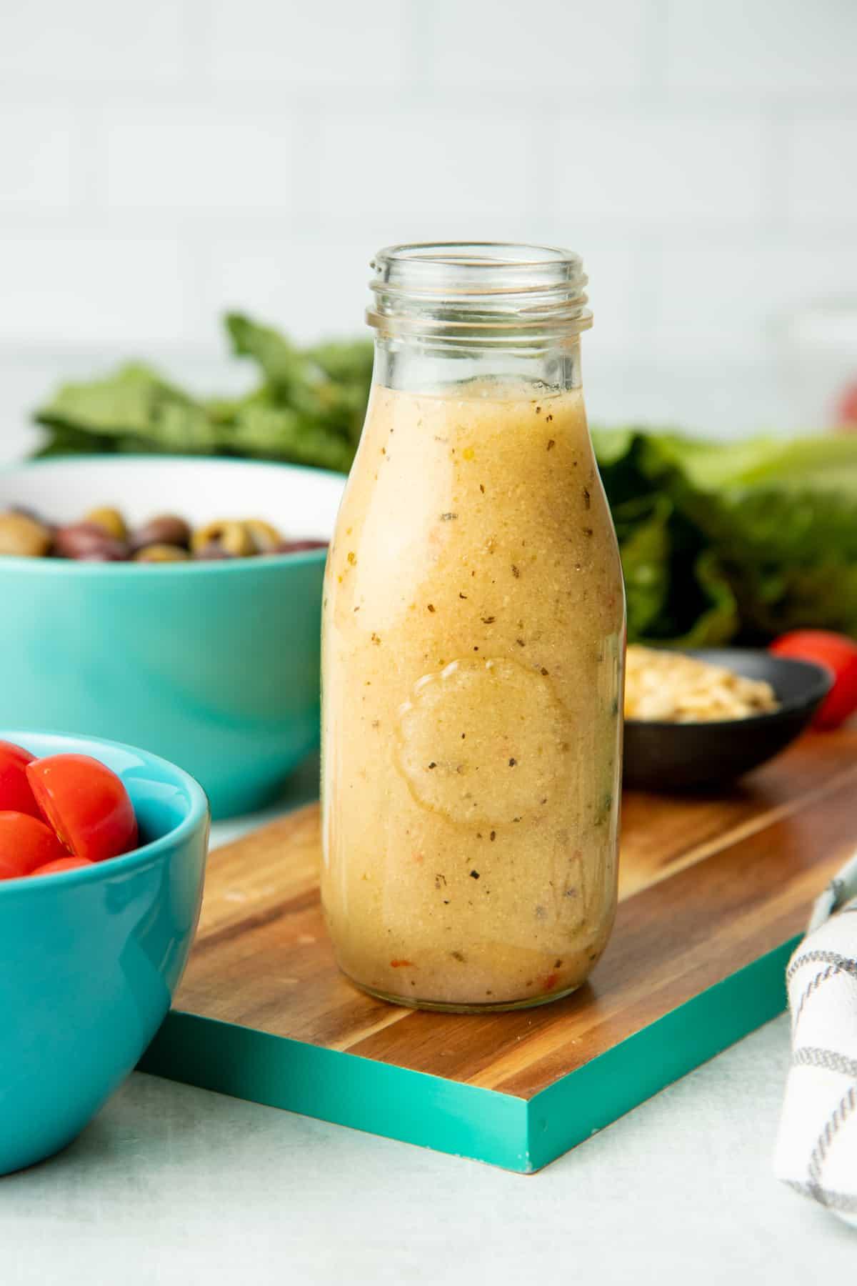 Glass bottle of homemade Italian salad dressing.