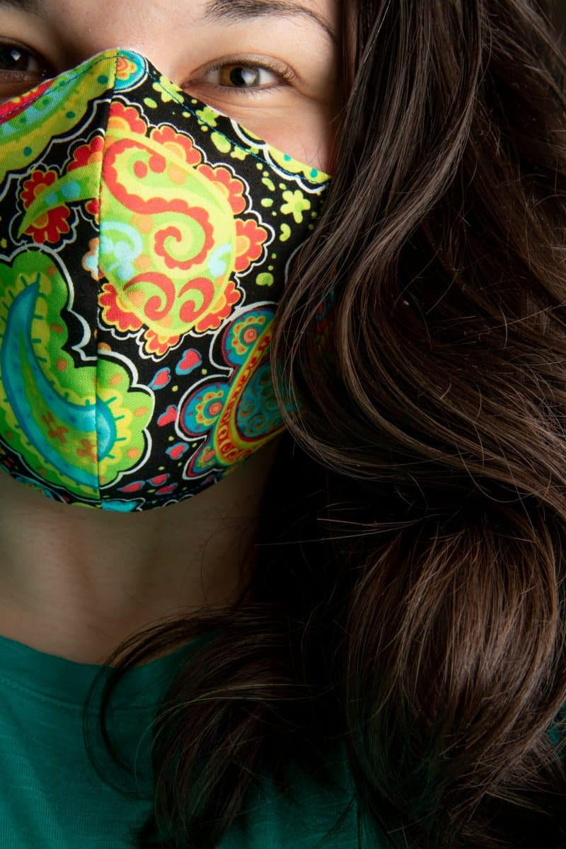 A woman wears the finished face mask.