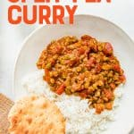"A bowl of Curry sits with a biscuit off to the side. A text overlay reads, ""Vegan Split Pea Curry""."
