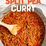 "A pot full of curry ingredients is stirred with a wooden spoon. A text overlay reads, ""Vegan Split Pea Curry""."