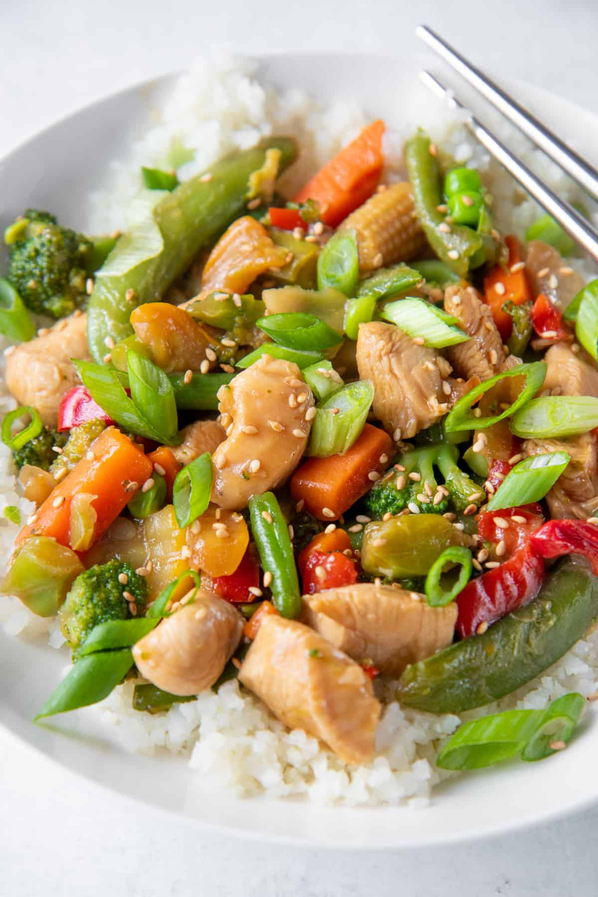 A close up shot of Healthy Chicken Stir Fry sitting in a bowl.