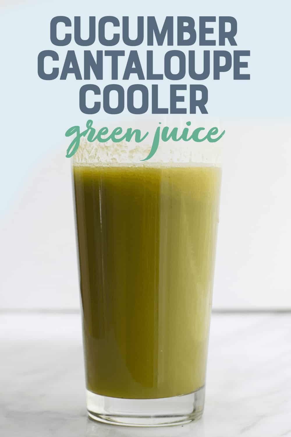 """Close-up of a tall glass of fresh cucumber cantaloupe cooler. A text overlay reads, """"Cucumber Cantaloupe Cooler Green Juice."""""""