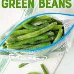 "Overhead of individually frozen green beans in an open zip-lock freezer bag. A text overlay reads, ""How to Freeze Green Beans."""
