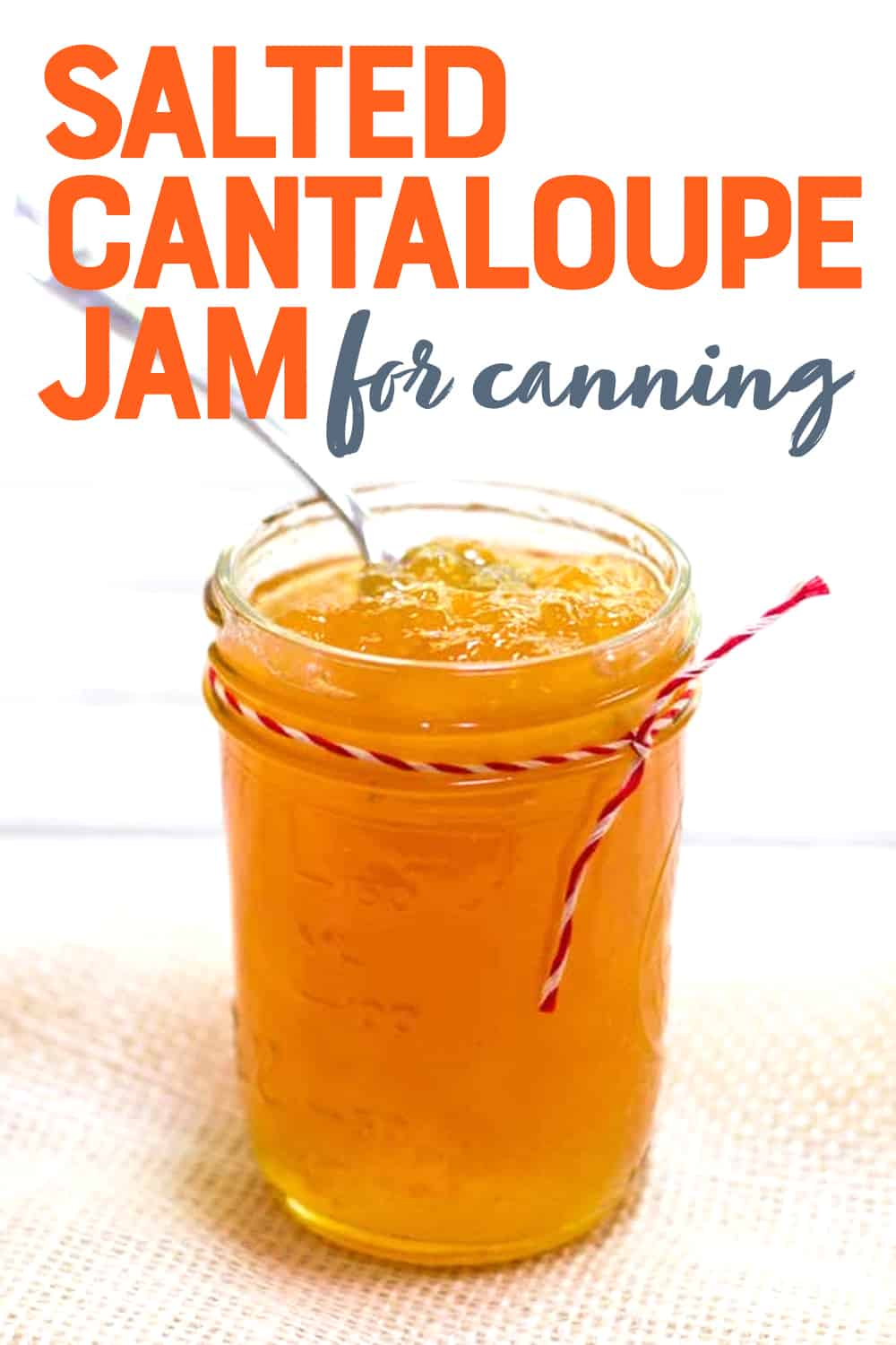 """Close-up of pint-sized canning jar full of salted cantaloupe jam. A text overlay reads, """"Salted Cantaloupe Jam for Canning."""""""