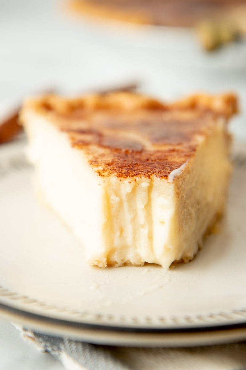 Close-up of a slice of pie with a bite taken out of it.