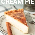 """A single slice of old fashioned sugar cream pie sits on a plate. A text overlay reads, """"Hoosier Sugar Cream Pie."""""""