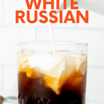 "Pouring cream into a rocks glass filled with homemade coffee liqueur, vodka, and ice. A text overlay reads, ""How to Make a Great White Russian."""