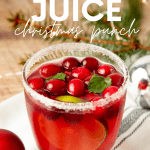 "A tumbler filled with jingle juice sits on a table with festive decorations around it. A text overlay reads, ""Jingle Juice Christmas Punch."""