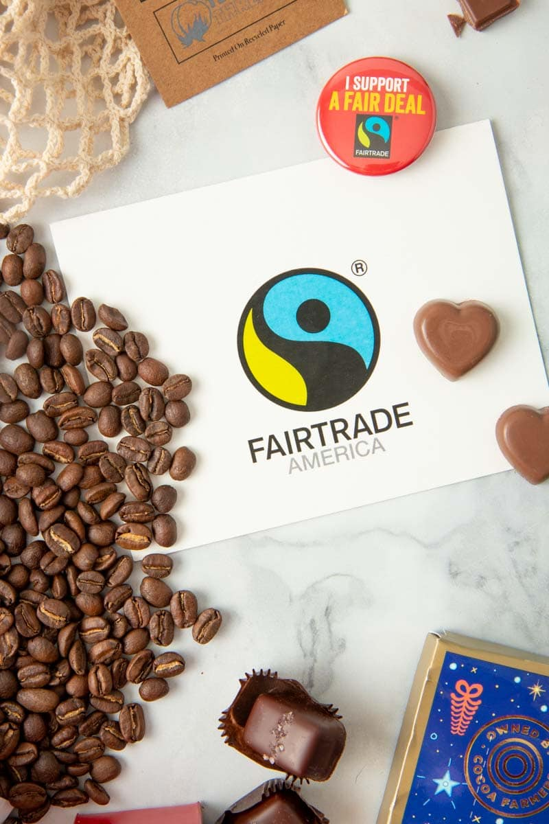 Close up on the Fairtrade America logo surrounded by fairtrade items
