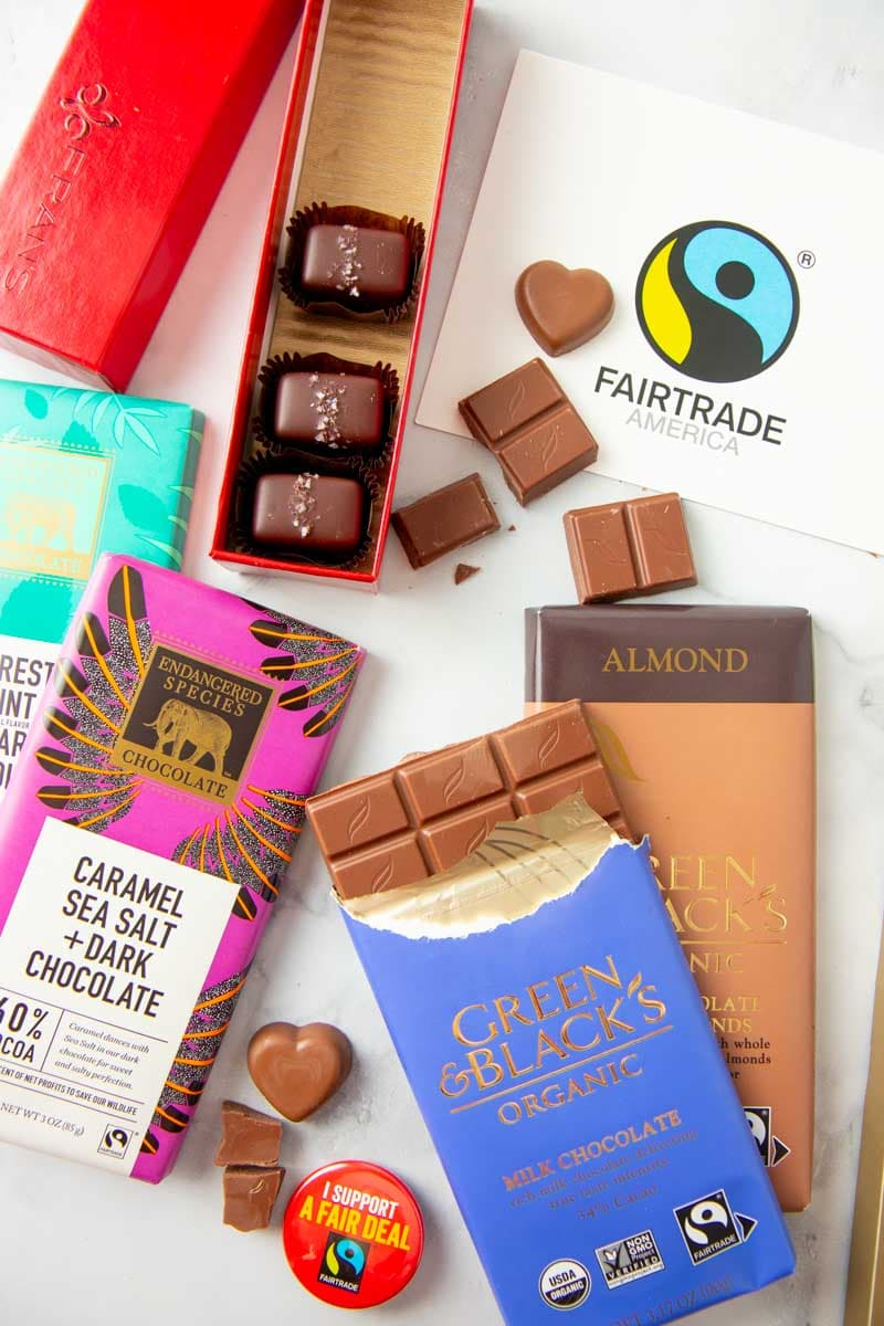 Fairtrade chocolates in various forms sit on a marble countertop.