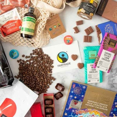 An assortment of fairtrade gift ideas are laid out on a tabletop.