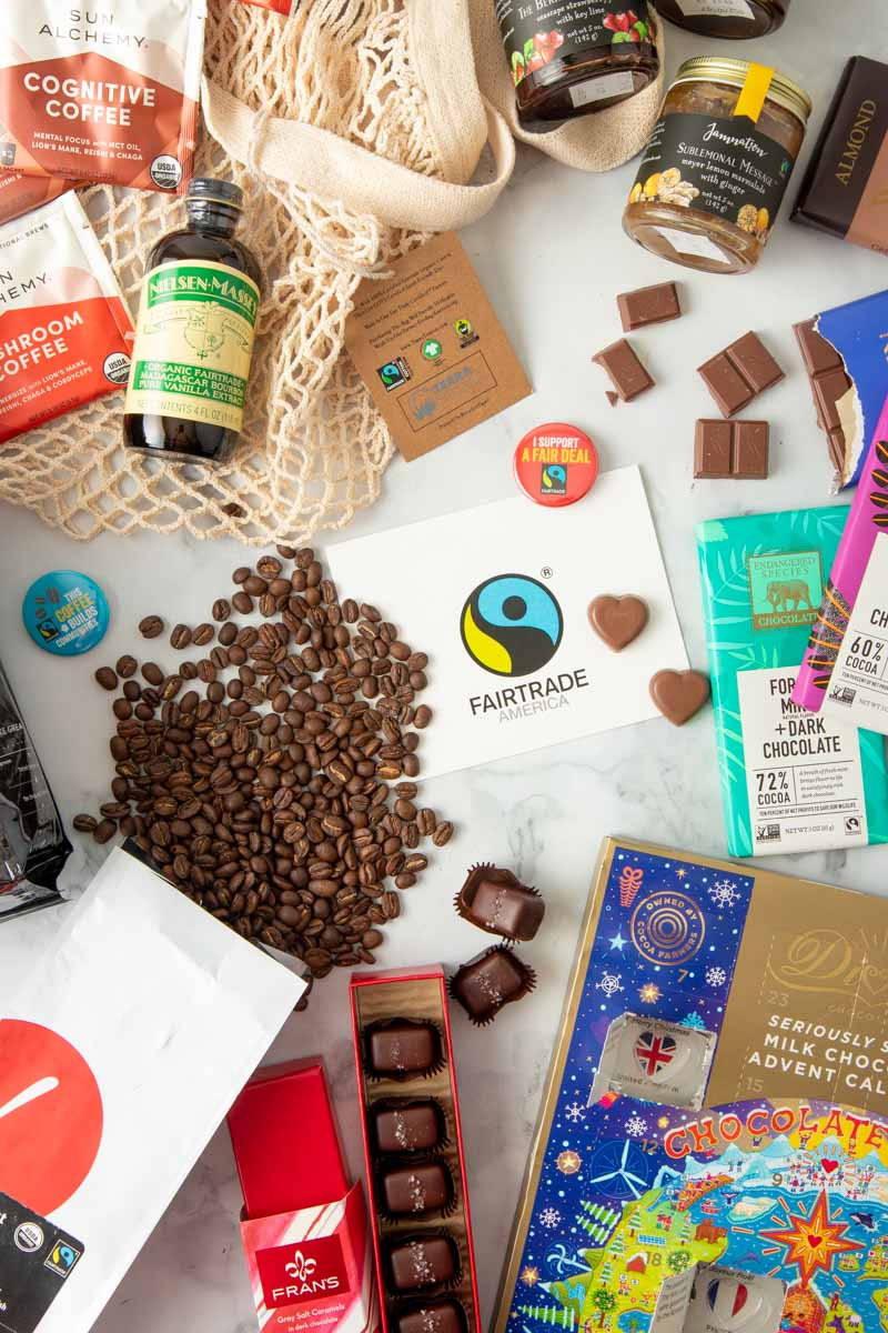 An assortment of fairtrade gift ideas are laid out on a table.