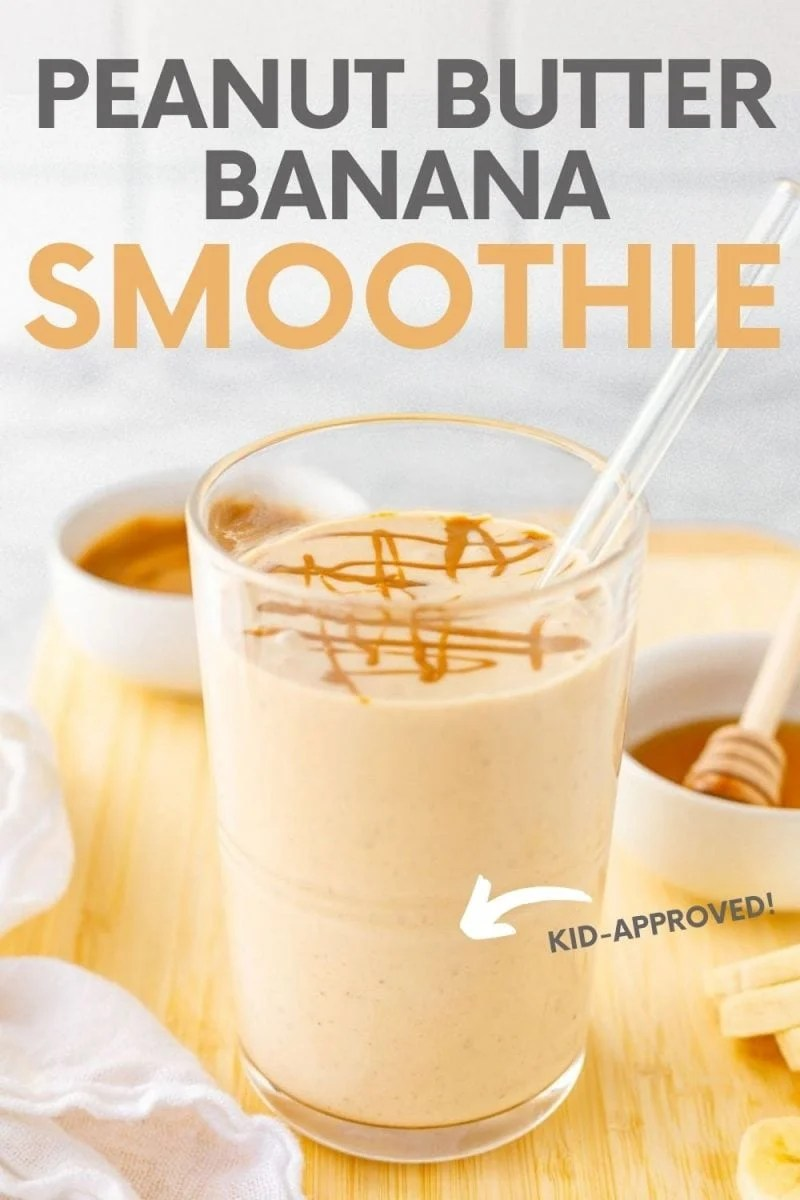 "Close-up of smoothie with glass straw on cutting board with fresh ingredients. A text overlay reads, ""Peanut Butter Banana Smoothie. Kid-Approved!"""