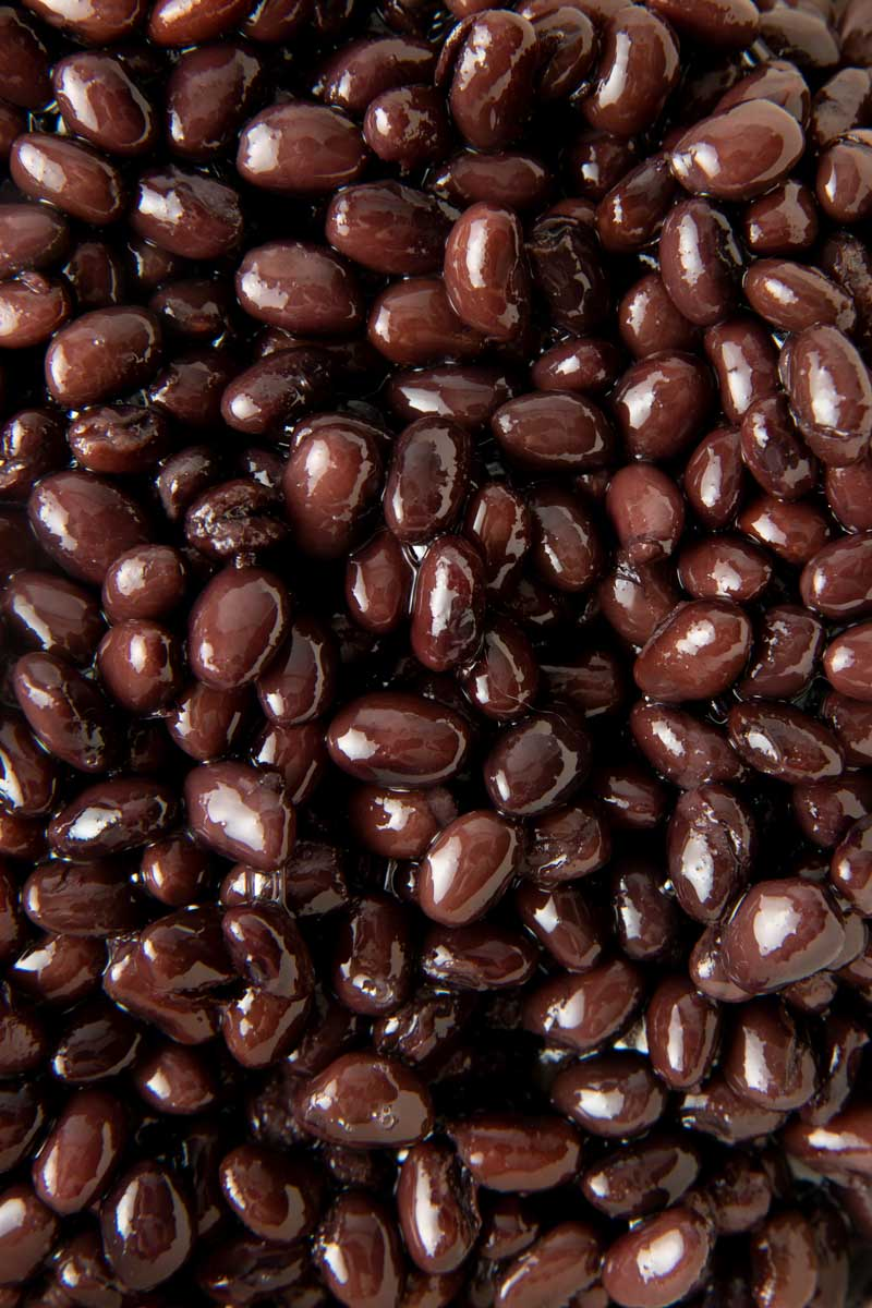 Close-up of perfectly cooked seasoned back beans.