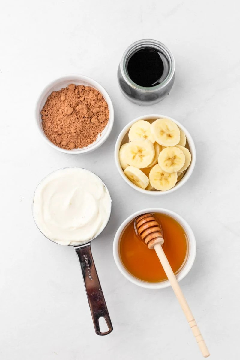 Overhead of ingredients to make mocha smoothie.