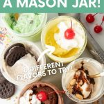 "Six mason jars, each holding a different flavor of mason jar ice cream. An ice cream scoop, sprinkles, cherries, and chocolate cookies are on the table around the jars. A text overlay reads ""How to Make Ice Cream in a Mason Jar! 6 Different Flavors to Try!"""
