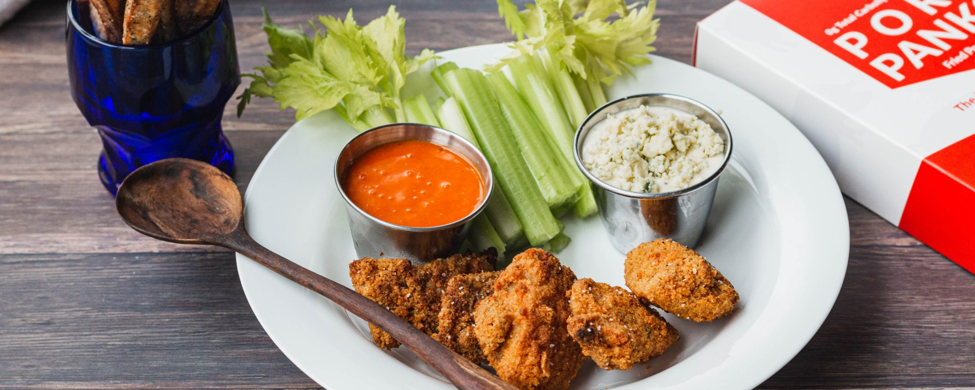 Bowl with paleo chicken nuggets, blue cheese dressing, habanero wing sauce, and celery