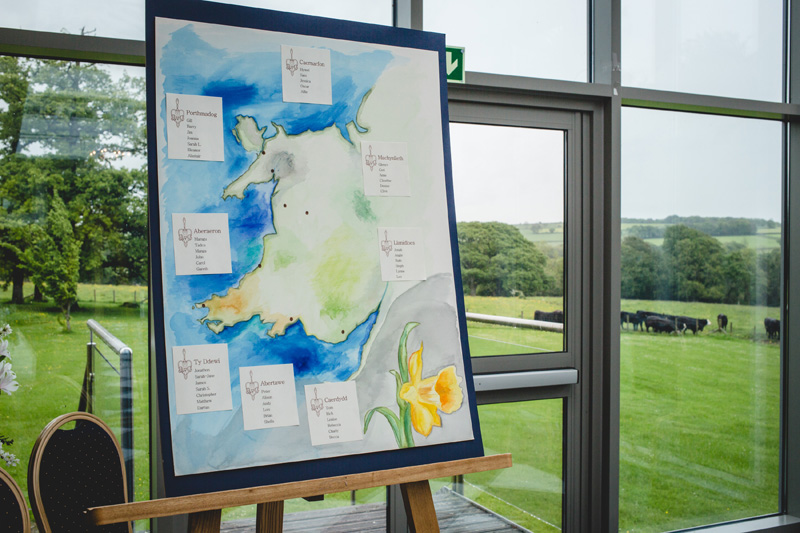 Table plan on beautiful handpainted watercolour map | Wedding at Rhosygilwen Mansion by Whole Picture Weddings