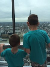 The 2 boys fascinated with the view.