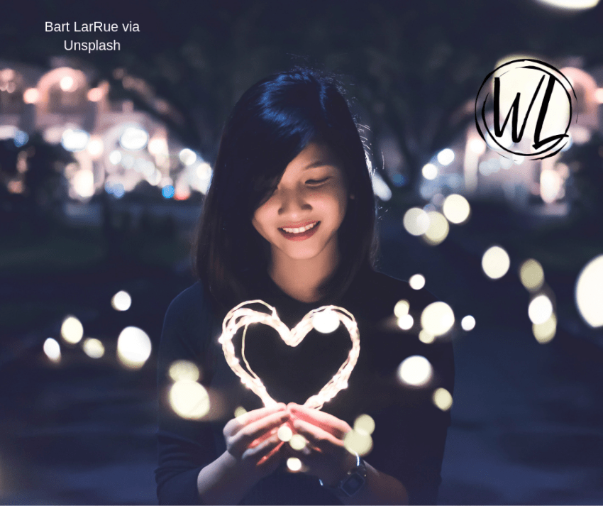 Girl with lit heart