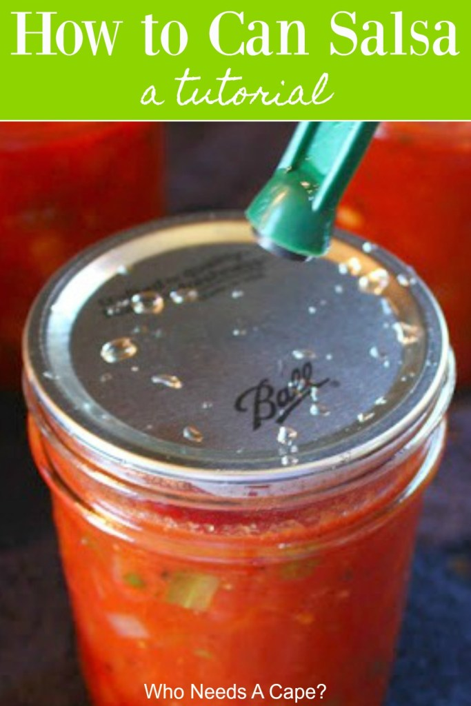 process shot of canning lid on canning jar full of salsa