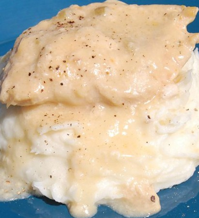 Slow Cooker Chicken & Gravy is pure comfort food straight from your crockpot. A delicious dinner served with mashed potatoes, so good!
