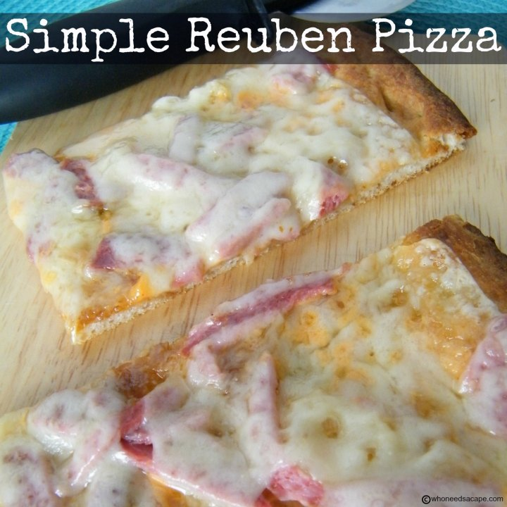 Simple Reuben Pizza, all the great flavors of the beloved sandwich on refrigerated pizza crust. Perfect way to use leftover Corned Beef.