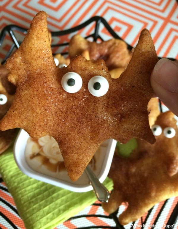 Need a fun snack for Halloween parties? Make these simple Halloween Sopapilla Crescents® with Creamy Caramel Dip! Loads of fun for the kids to help prepare.