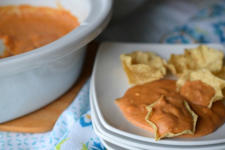 Slow Cooker 3 Cheese Bean Dip is perfect for parties of any type. Easy to make, your guests will love the cheesiness of this delicious dip.