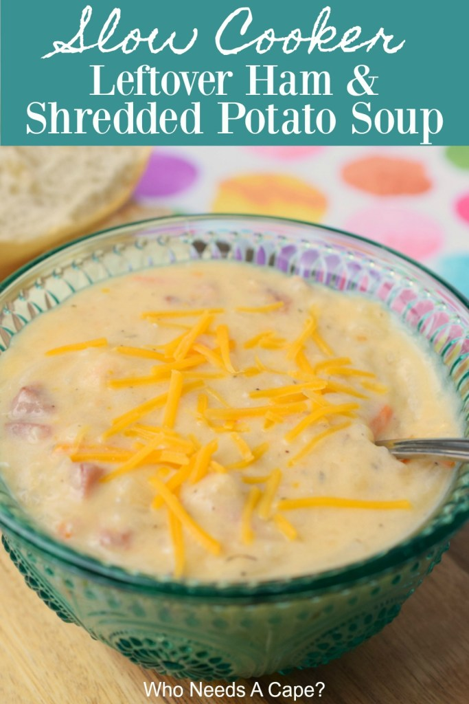soup with shredded cheese in blue glass bowl with crusty bread and polka dot table cloth