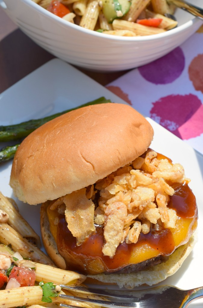 Fire up the BBQ grill and make some Cheddar Barbecue Burgers with Crispy Onions! An easy to prepare hamburger that is popping with delicious flavors.