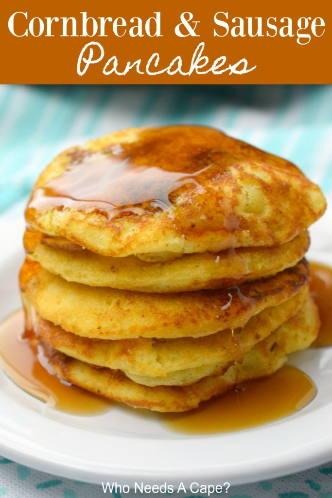 cornbread and sausage pancakes with syrup on white plate on blue and white fabric