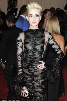 Anne Hathaway looks fantastic in this shear Valentino gown. Cropped spiky blonde suits her. It was a total and much a warranted removal from the sweet feminine side we are so bored of seeing. She rocks this and her boobs look great!