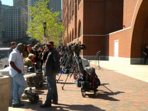 Reporters line up outside the courthouse in Boston where the Marathon bombing trial took place. None have yet spoken with Viskhan Vakhabov, who declined to testify at the trial though he received a phone call from the convicted bomber immediately following the attacks. Photo credit: Jill Vaglica