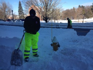 UConn Fire Lieutenant Scott McDonald finishes digging out a fire hydrant with his colleague. (Photo by Sylvia Cunningham/WHUS News)