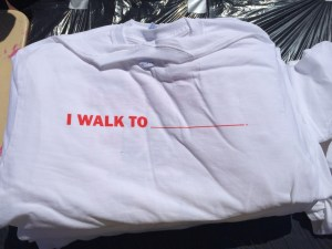 "Shirts given out at the event read ""I walk to ______"", with participants given the option to fill in the blank. (Photo: John Ewen)"