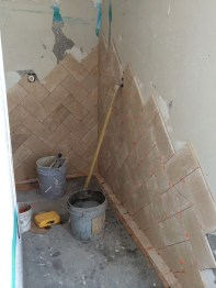 One poor tile layer spent 4 straight days in the master shower laying out my requested herringbone pattern!