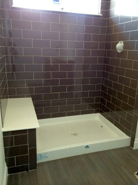 Bathroom #1 with brown shower tile