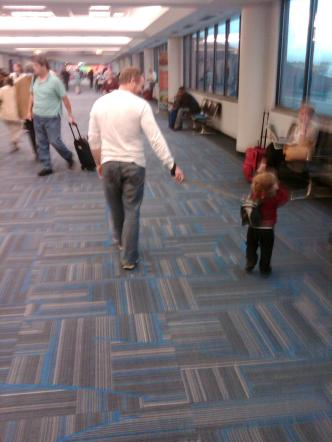 Kid Leash? I just walked past this little scenario at Dulles International Airport!