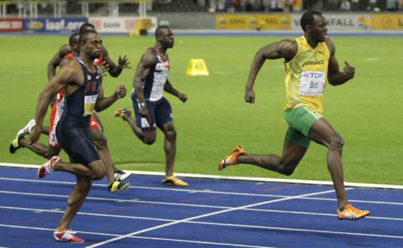 Jamaica's Usain Bolt, right, crosses the finish line ahead of Tyson Gay of the United States, right, to set a world record in the men's 100 meters at the IAAF World Championships in Berlin on Sunday. (Herbert Knosowski / Associated Press / August 16)