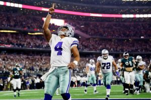 Dak Prescott of the Dallas Cowboys celebrates after scoring in the first quarter during a game between the Dallas Cowboys and the Philadelphia Eagles at AT&T Stadium on Oct. 30, 2016 in Arlington, Texas. (Credit: Getty Images / Ronald Martinez)
