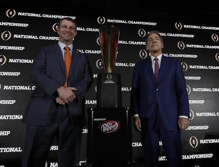 Clemson head coach Dabo Swinney and Alabama head coach Nick Saban pose with the championship trophy during a news conference for the NCAA college football playoff championship game Sunday, Jan. 8, 2017, in Tampa, Fla. (AP Photo/David J. Phillip)