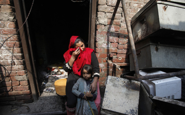 REUTERS/MOHSIN RAZA Anzila Semeul cries while sitting with her daughter in front of their home, after it was burnt by a mob two days earlier, in Badami Bagh, Lahore March 11, 2013. Hundreds of Pakistani Christians took to the streets across the country on Sunday, demanding better protection after a Christian neighbourhood was torched in the city of Lahore a day earlier in connection with the country's controversial anti-blasphemy law.